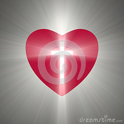heart shape with a shining cross inside stock illustration