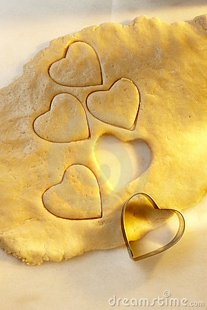 Heart shaped cookie cutter with dough