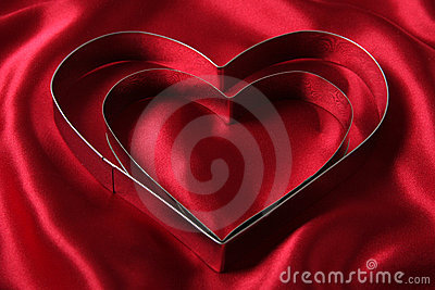 Heart Shaped Cookie Cutters on Red Satin