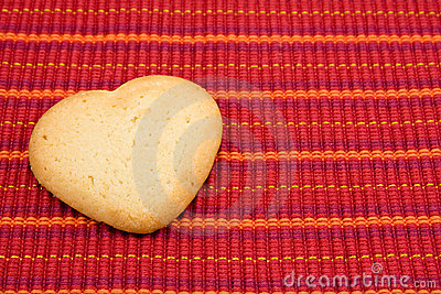 Heart shaped cookie on red  tablecloth