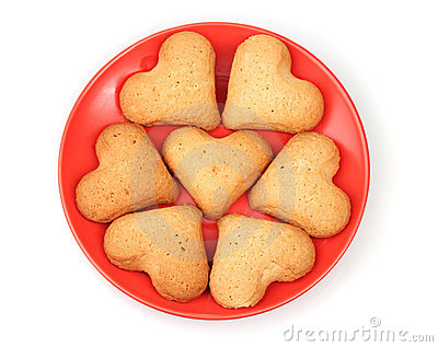 Heart-shaped cookies on red saucer