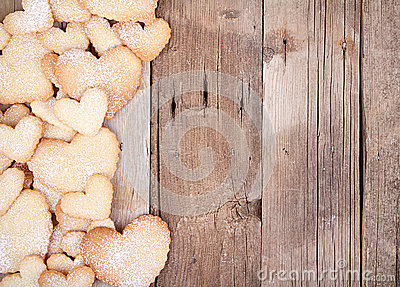Heart shaped cookies on wooden background