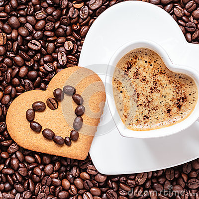 Free Heart Shaped Cup And Cookie On Coffee Beans Background Royalty Free Stock Photos - 46742828