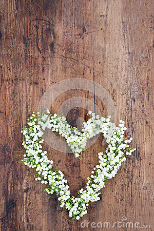heart shaped flower wreath on rustic background stock