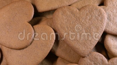 Heart shaped gingerbread, baking. Close up stock video footage