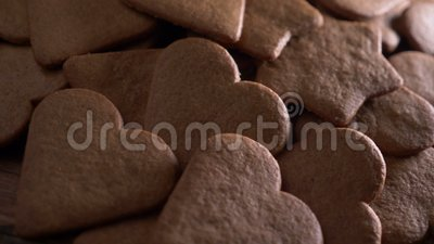 Heart shaped gingerbread, baking. Close up stock footage