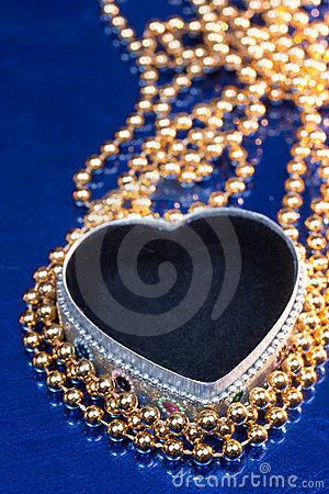 Heart shaped jewel box with golden beads