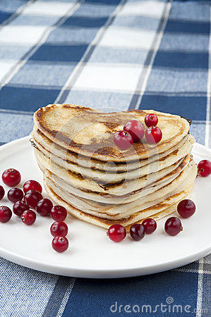 Heart shaped pancakes with cranberries.