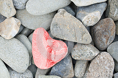 Heart shaped stone painted on red
