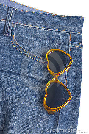 Heart Shaped Sunglasses in the Pocket of Denim Blu