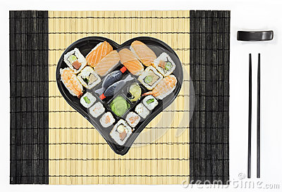 Heart shaped sushi plate on tablemat