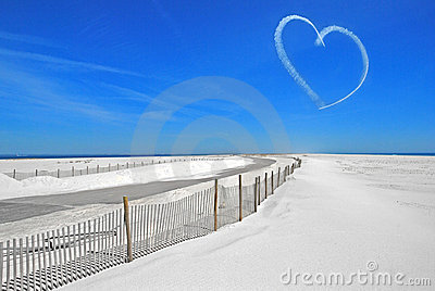 Heart in sky over beach
