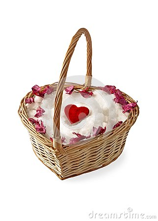 Heart on the snow in a wicker basket