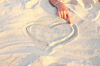 Heart symbol drawn in the sand 2