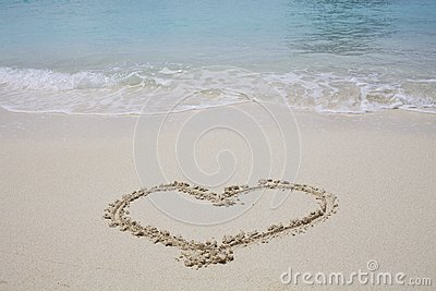 Heart Symbol on sand beach
