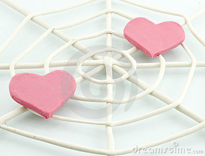 Heart trapped in a spider web.
