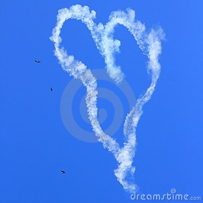 Heart skywriting with birds in sky