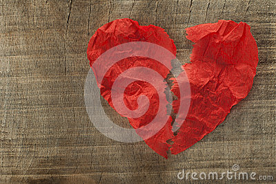 Heartbreak made of curled red paper