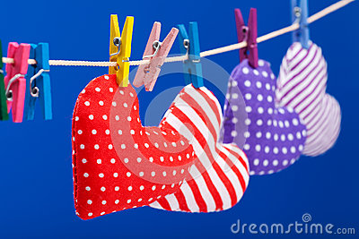 Hearts hanging on a clothesline with clothespins