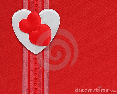 Hearts and ribbon on a red background