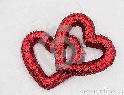 Hearts on snow background