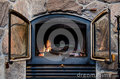 Fireplace in a rustic stone chimney