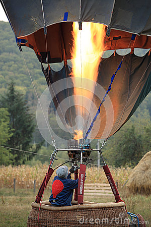 Heating the hot air balloon before lifting off Editorial Image