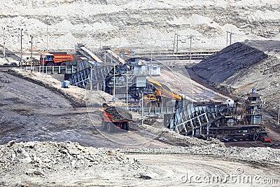 Heavy construction tipper trucks dump coal