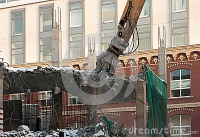 Heavy dredger demolishes building