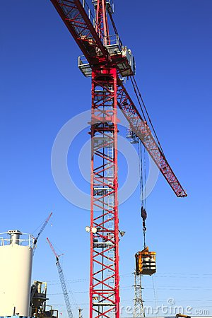 Heavy duty cranes on worksites.