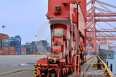 Heavy equipment in container yard beside dock, Xiamen, China Editorial Stock Photo