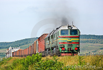 Heavy freight train pulled by diesel locomotive