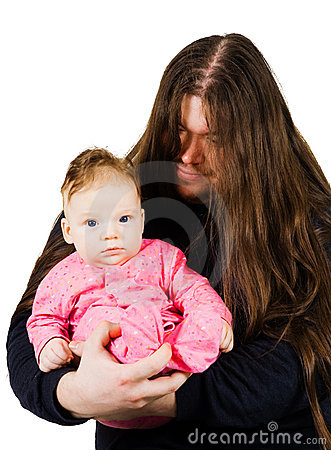 Heavy metal father singing lulaby to his son