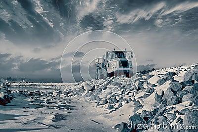 Heavy pick-up truck in rough terrain