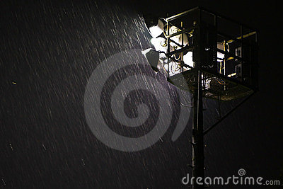 Heavy rain in night spotlight