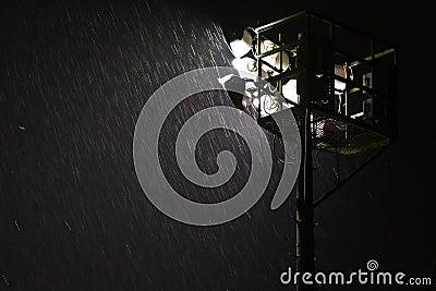 Heavy rain in night spotlight