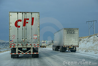 Heavy trucks speeding on icy freeway Editorial Photography