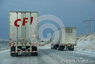 Heavy trucks speeding on icy freeway Editorial Photography