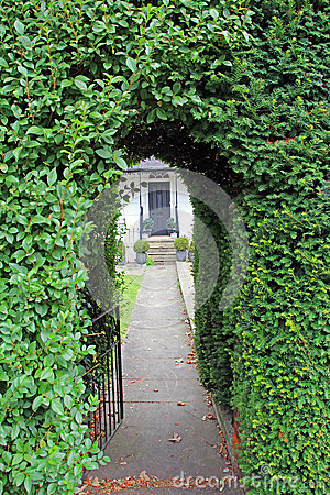 Hedge keyhole arch pathway gate stock photo image 44650847 for Garage door repair round lake il
