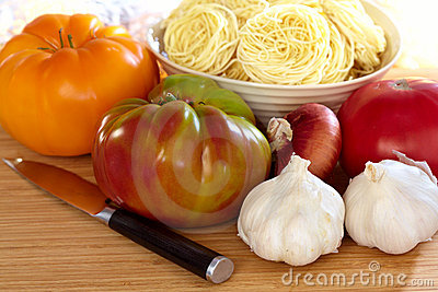 Heirloom Tomatoes, Onion, Garlic, Pasta and Knife