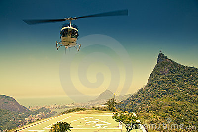 Helicopter in air in front of Corcovado Rio