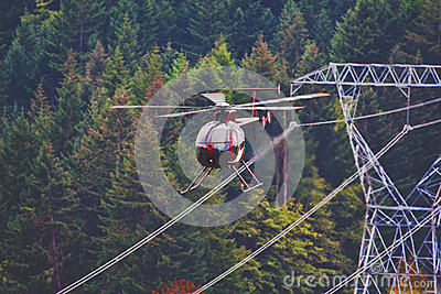 Helicopter Flying Next To Power Lines