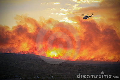Helicopter flying over fire