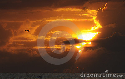 Helicopter flying at sunset