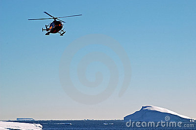 Helicopter over icebergs