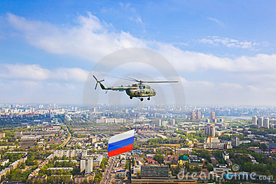 Helicopter with russian flag over Moscow at parade