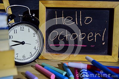 Hello october on phrase colorful handwritten on blackboard Stock Photo
