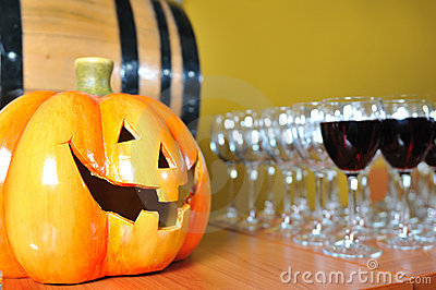 Helloween party pumpkin and wine glasses
