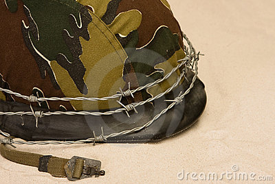 Helmet and barbed wire