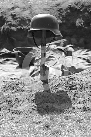 German second world war II helmet on a shovel